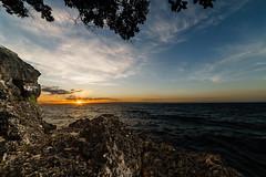 Alexis Cliff Dive (Hendraxu) Tags: ocean sunset sea sky cliff cloud sun water rock stone seaside asia dusk philippines wave bohol manual seashore manualfocus