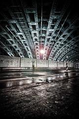 Monsieur Tati under the bridge... (Revierfotograf) Tags: bridge night gangster steel slum