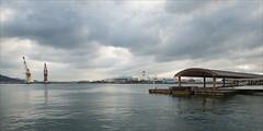 hiroshima-1492-ps-w (pw-pix) Tags: blue mountains water japan port grey dock afternoon cloudy harbour jetty overcast hiroshima cranes ferryterminal pontoon lateafternoon hiroshimako