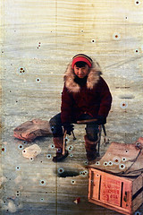 30-155 (ndpa / s. lundeen, archivist) Tags: ocean winter boy sea people snow color fall film ice hat 30 alaska 35mm coast town frozen fishing chair sitting village child boots native nick spots coastal gloves 1970s damaged crate 1972 seated distressed youngman icefishing parka unidentified alaskan dewolf nativealaskan discolored heatdamage damagednegative furlined nickdewolf photographbynickdewolf coastalvillage reel30
