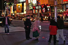NYPD (raymondclarkeimages) Tags: street newyorkcity people usa ny night canon photography lights neon photographer traffic police nypd business le 10d timessquare cop pedestrians stores lawenforcement rci imageof pictureof picof raymondclarkeimages 8one8studios