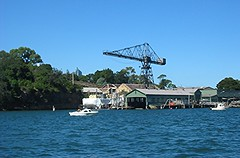 Goat Island dockyard & Hammerhead Crane. (NevDev (Nev)) Tags: australia newsouthwales nsw geotagged marine maritime maintenance repair ferry vessel watercraft water wharf wharves jetty dock green trees shore shoreline outdoor ship boatyard shipyard waterfront waterscape goatisland island hammerheadcrane crane sydney canon canonpowershota30 canoncamera portjackson boat shipping transport metal steel urbex decay ruin industry industrial abandoned old shipbuilding relic