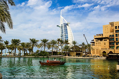 Past and Present (Neeraj.M) Tags: sky lake water pinetree creek canon landscape eos boat dubai uae middleeast wideangle arab burjalarab coconuttree jumeira madinatjumeira greenwater uniterarabemirates 1dmark4