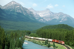 rr7481 (George Hamlin) Tags: railroad trees red lake canada mountains barn train river photography photo george big scenery diesel grain rail louise covered alberta locomotive cp curve empties decor freight hoppers eastbound 2014 hamlin emd sd402f morants