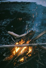 Sam Makes a Bonfire (Rachael.Robinson) Tags: winter light canada man color film beach 35mm island fire flames bonfire fujifilm sparks campobello