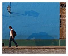 the play of light and shadow (kurtwolf303) Tags: city blue urban man building topf25 facade person licht topf50 topf75 colorful 500v20f cuba streetphotography haus stadt trinidad caribbean lantern topf150 laterne topf100 lightshadow schatten kuba omd fassade karibik lichtschatten 900views urbanlifeinmetropolis 1500v60f 1000v40f 250v10f systemcamera unlimitedphotos strasenfotografie micro43 microfourthirds olympusem5