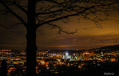 Presiding over a city (Safarii) Tags: city longexposure light sky urban orange tree church abbey silhouette night buildings landscape evening bath glow cityscape pollution nightlife sprawl humans lightpollution bathabbey urbansprawl