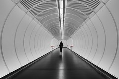 ...U1... [explored 28, april 2016] (ines_maria) Tags: vienna wien city urban bw woman white underground subway austria geometry candid running symmetry human ubahn