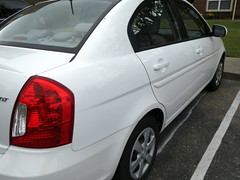 White Hyundai Accent. (dccradio) Tags: white car nc northcarolina transportation vehicle greenery hyundai accent lumberton 2011 robesoncounty walnutmanorapartments