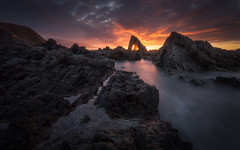 Vallina Beach (Asturias, Spain) (Tomasz Raciniewski) Tags: ocean light sunset espaa sun seascape beach rock landscape atardecer coast mar spain agua outdoor sigma asturias playa shore 1020 rocas haida cantabrico occidente nd400 vallina d3200