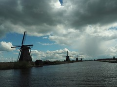 Dutch landscape (S.w.C.photography!) Tags: blue sky holland nature water windmill rain silhouette clouds photography thenetherlands bluesky kinderdijk swcphotography