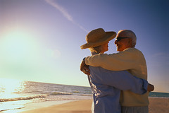 CB044121 (robin-wickens) Tags: 2 people men love wearing photography hugging women affection colorphotography hats couples romance elderly beaches males whites females caring humanrelationships adults seniors coasts headgear interactions strawhats clothingaccessories