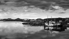 living by and off the sea (lunaryuna (off to Iceland for 2 weeks)) Tags: sky bw seascape water monochrome norway clouds reflections landscape boats blackwhite bridges lunaryuna cloudscape seeingdouble islets lofotenislands norwegiansea lofotenarchipelago northernmirrorworlds