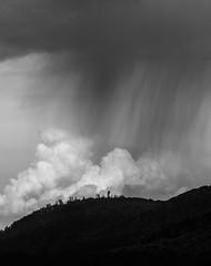 A moment of touch.. (George Pancescu) Tags: sky blackandwhite cloud storm nature monochrome rain clouds landscape nikon natural outdoor dramatic romania cumulus 70200mm rasnov d810 outstandingromanianphotographers
