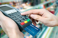 EMV: Better Safe Than Sorry (bestofcategoryreviews) Tags: people food white man shop retail closeup person store code holding hand close reader market sale wallet machine bank terminal supermarket plastic business butcher card credit pay buy customer grocery financial selling purchase consumerism cashier finance shopper payment transaction paying swipe debit