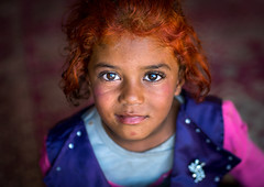 Gypsy girl with red hair, Central County, Kerman, Iran (Eric Lafforgue) Tags: poverty portrait people orange cute girl face childhood horizontal closeup photography kid eyes asia child iran character traditional poor culture adorable persia headshot redhead indoors tribes nomad henna tribe gypsy gypsies kerman cultural oneperson middleeastern frontview nomadic lookingatcamera 1people onegirlonly onlychildren colourpicture khoshneshin irandsc06932