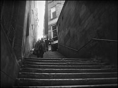 halfway past the pub (alanpeu1) Tags: film monochrome mediumformat edinburgh closes analogue oldtown mamiya645 halfway delta400 hoose