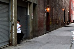 Back Alley Break (Jane Olsen ( Chardonnay)) Tags: woman brick calgary lights uniform downtown backalley cigarette cellphone cell alleyway backlane parkingsigns