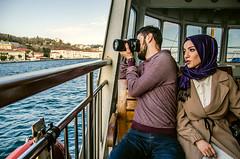 In a parallel universe (Melissa Maples) Tags: woman man water ferry turkey boat nikon couple asia photographer muslim trkiye hijab istanbul nikkor strait bosphorus vr afs  karaky goldenhorn 18200mm  f3556g  18200mmf3556g d5100