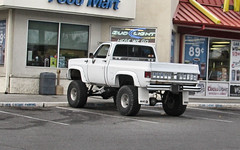 Lifted '70s K10 (Eyellgeteven) Tags: classic chevrolet truck vintage gm 4x4 pickup pickuptruck chevy chrome vehicle 1970s gmc k10 fourwheeldrive louvres lifted chev generalmotors bigtires 12ton generalmotorscorporation shortbed eyellgeteven