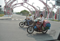 Loaded up (Roving I) Tags: street vegetables fruit transport vietnam motorbikes loads danang helmets
