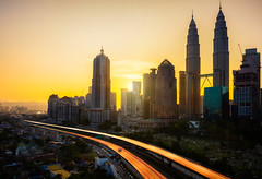 Kuala lumpur skyline (Patrick Foto ;)) Tags: city travel sunset sky urban sun motion building tower cemetery car horizontal skyline architecture night skyscraper sunrise asian daylight twilight asia downtown cityscape exterior view place traffic angle dusk contemporary district traditional famous horizon petronas formal culture landmark center scene structure business international malaysia tropical tall kuala kualalumpur southeast malaysian financial lumpur finance destinations my wilayahpersekutuankualalumpur