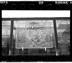 Chinese Food Italian Pizza Guy Sign (New Paltz Camera Company) Tags: new york food white ny black monochrome sign yellow analog 35mm liberty nikon kodak scanner trix chinese bob d76 filter developer 400 epson analogue v600 expired esposito fm2