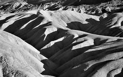 Badland Formations at Zabriskie Point (Black & White, Death Valley National Park) (thor_mark ) Tags: california day2 nature blackwhite unitedstates deathvalley blueskies portfolio desertlandscape deathvalleynationalpark lookingse project365 colorefexpro erosionallandscape badlandformations nikond800e amaragosarange capturenx2edited triptodeathvalleyandcalifornia westgreatbasinranges atzabriskiepoint
