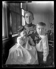 Victorian photograph of a woman with her two children in their home in Fallston, Maryland. (Remsberg Photos) Tags: blackandwhite usa baby blur window vintage children infant child antique mother maryland son historic pottedplants scanned eyeglasses motherhood glassplate fallston harfordmd