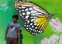 man in front of a painted butterfly on a wall, Hormozgan, Bandar Abbas, Iran (Eric Lafforgue) Tags: street travel people urban man flower men art tourism horizontal wall illustration butterfly painting outdoors photography graffiti asia iran persia daytime adultsonly oneperson lookingaway middleeastern persiangulf bandarabbas menonly youngadultman hormozgan  onemanonly waistup  1people  iro straitofhormuz  colourpicture  iran034i1762