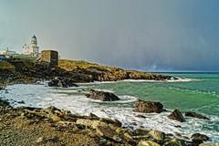 Winter sunshine. (artanglerPD) Tags: lighthouse clouds rocks snowy fraserburgh