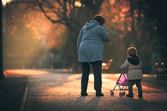 An evening with grandma (Gure Elia) Tags: street city winter sunset urban atardecer december child grandmother bokeh ciudad nia f2 nio diciembre pamplona taconera canoneos550d samyang135f2