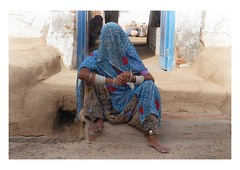 modest anonymity (handheld-films) Tags: street old travel blue portrait people woman india home closeup female women veiled indian families culture villages hidden doorway elderly portraiture aged society sari subcontinent ruralindia