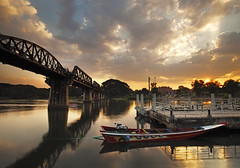 Bridge on the River Kwai at Kanchanaburi (SedatPhotography) Tags: bridge sunset holiday clouds river landscape thailand boat amazing place be kanchanaburi visited kwai tatil amazingthailand tayland