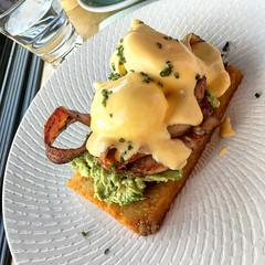 Oscar's Benedict, poached eggs on bacon, smashed avocado and potato rosti