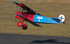 We Have Liftoff (jrussell.1916) Tags: blue red aircraft airplanes kansas biplane shawneemissionpark remotecontrolaircraft canon400mmf56lusm airplanesinflight