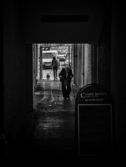 dark tunnel (Daz Smith) Tags: city uk portrait people urban blackandwhite bw woman streets blancoynegro monochrome canon dark blackwhite bath candid citylife thecity streetphotography tunnel disabled dogwalker canon6d dazsmith bathstreetphotography