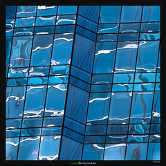 Windows' got the blues (Ilan Shacham) Tags: blue windows urban usa abstract reflection building glass boston architecture modern square us view geometry massachusetts fineart scenic warp warped hitech repitition fineartphotography