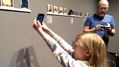Instantly Yours & Off the Fridge closing party, 2/26: A little fan takes a picture of her parent's purchase, as PRC board member Bruce Myren readies a blue dot! (PRCBoston) Tags: boston polaroid photography prc bostonsnow bostonuniversity instantphotography cryptid leftofcenter photographicresourcecenter exhibitionclosing bostonphotography impossibleproject bostoncold instagram offthefridge instantlyyoursaoneofakindexhibitionofinstantinstagramphotography instantlyyoursprc