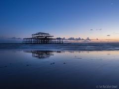 New Moon (Sue MacCallum-Stewart) Tags: blue sunset seascape sussex brighton westpier lowtide