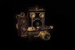 ...a trio of fun... (jamesmerecki) Tags: old blackbackground modela vintage indoor cameras target brownie ansco 1929 eastmankodak six16 leicai memobox