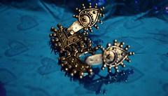 A ten year old trinket...  Nostalgic... (lsm9) Tags: earring jewelry nostalgia trinket blackmetal