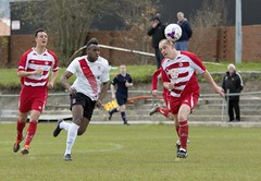 Joel Kasubandi shapes to pounce on the shoulder of Bryan Slavin (Stevie Doogan) Tags: park west scotland thistle scottish first juniors division league holm largs clydebank superleague bankies mcbookiecom