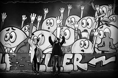 hands up (bostankorkulugu) Tags: street urban blackandwhite bw white black art monochrome wall sepia turkey graffiti blackwhite eyes couple europe faces trkiye istanbul nikos bostanci handsup beyoglu istiklal bostan pera korkut eller chrysoula istiklalstreet bostankorkulugu