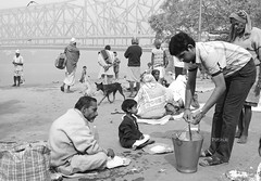 Lunch by the river side 1 (pathikdebmallik) Tags: boy food dogs river bag lunch child rice riverside ngc hungry riverbank kolkata calcutta scavengers pilgrims howrahbridge