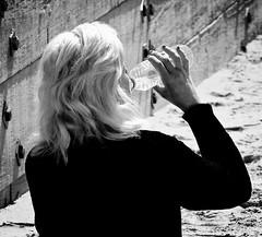 BackWater (Hodd1350) Tags: bw beach female mono blackwhite back sand women drinking wb olympus panasonic dorset blonde groyne bournemouth waterbottle whiteblack boscombe penf lumixlens