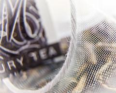 Luxury Tea (L E Dye) Tags: canada nikon alberta teabag macromonday d5100 20mmextentiontube themebag luxurytea ledye