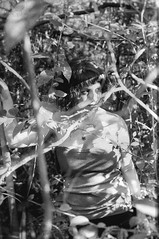 (Nowhere land ) Tags: portrait blackandwhite woman naturaleza sunlight byn blancoynegro nature girl look mujer chica retrato bn hidden vegetation mirada vegetacin escondida