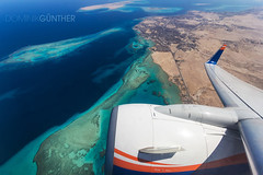 Departing Hurghada (domingo_95) Tags: city red sea sun plane canon germany airplane coast airport view aircraft aviation wing egypt engine express boeing tamron departure hurghada 737 departing marsa alam 1024 planespotting 738 wingview avgeek 60d