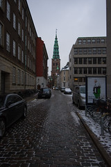 Nikolaj Contemporary Arts Center (Stephen Brown - smb51095) Tags: street travel winter urban color colour tower castle architecture copenhagen denmark photography design alley nikon colorful europe angle photos wide january pedestrian spire cobble cobblestone photographs alleyway 2016 7200 d7200